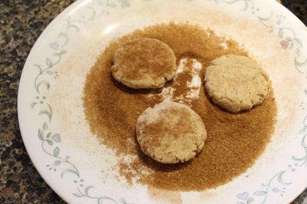 Snickerdoodles rolling in cinnamon sugar