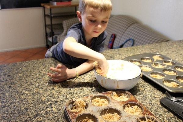 Child helping make potato latkes