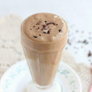 Chocolate milkshake in a tall glass.