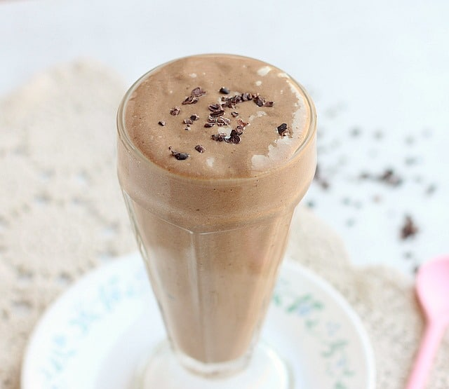 Chocolate milkshake in a tall glass.