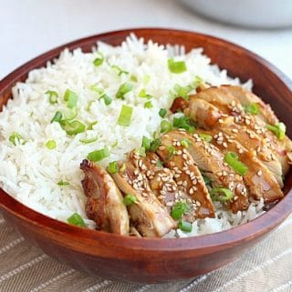 Teriyaki chicken and white rice in a brown bowl.