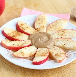 Peanut butter and apples on a plate