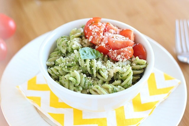 Spinach basil pesto pasta with fresh tomatoes